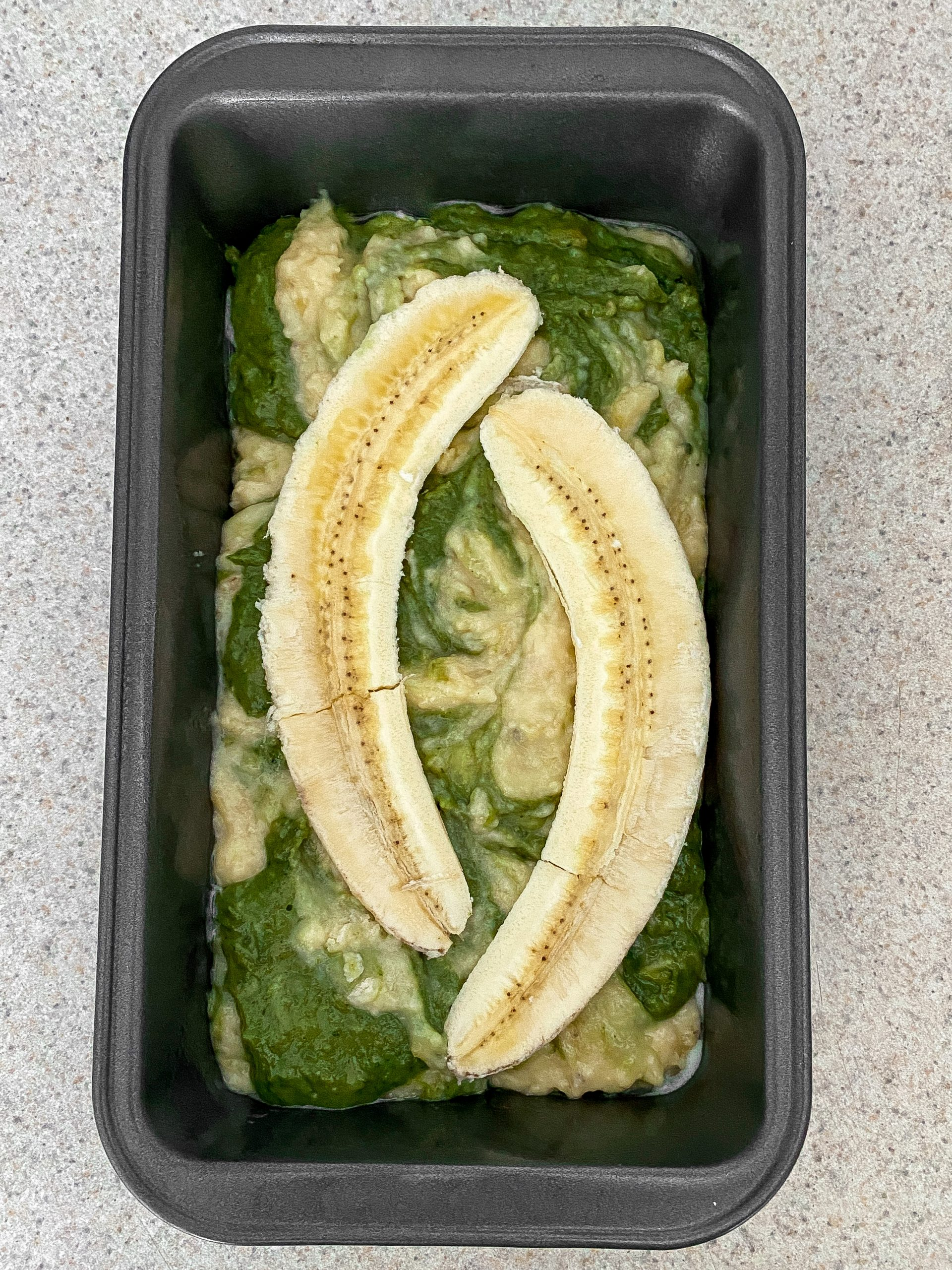 A pre-baking look at the swirled matcha banana bread.