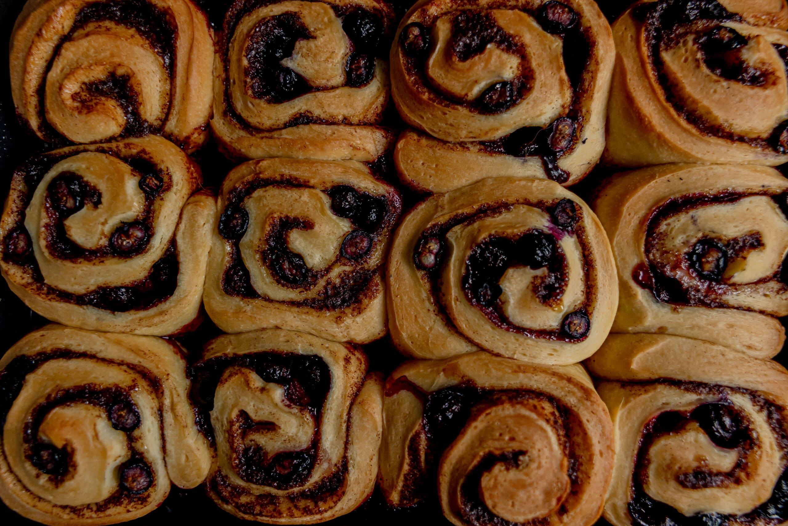 Unfrosted cinnamon buns to show the ideal level of browning