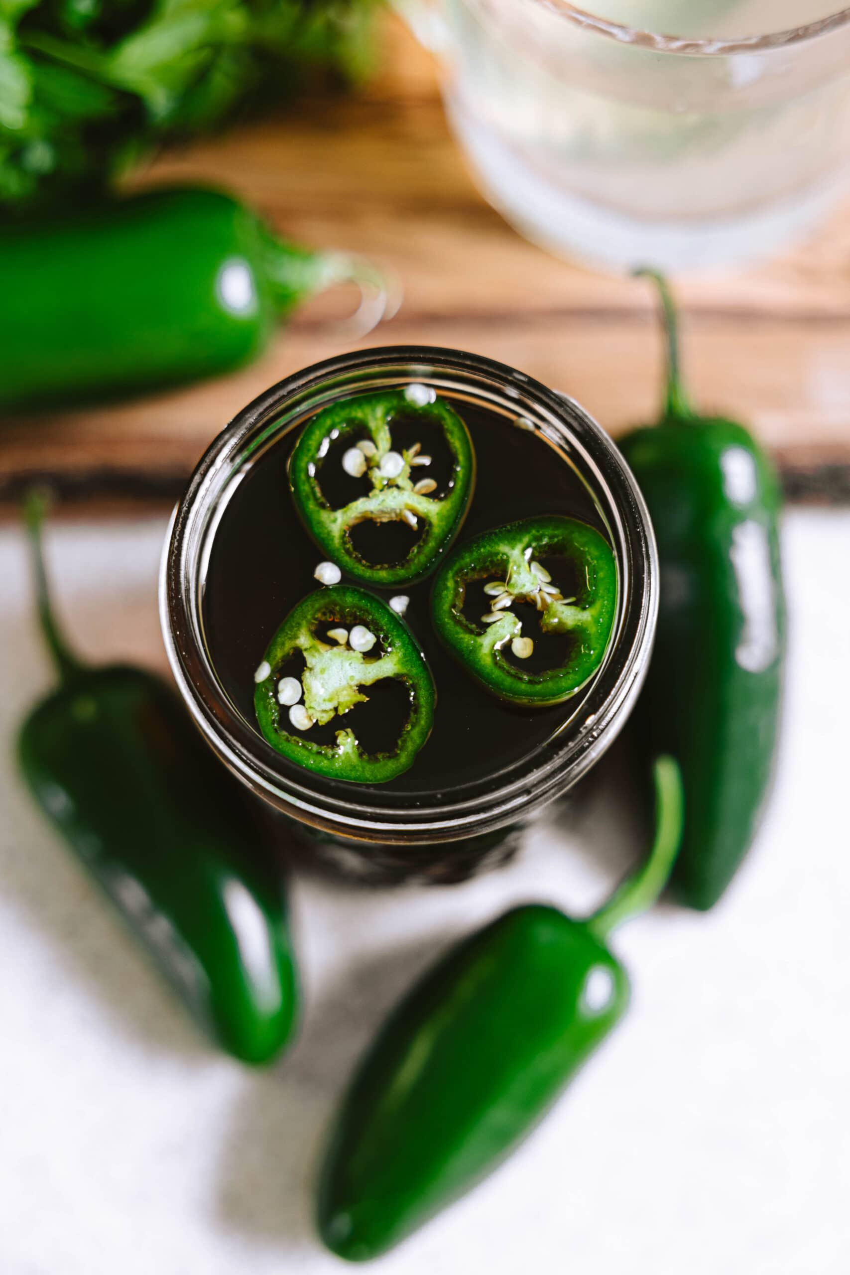 The syrup around 4 jalapeño peppers